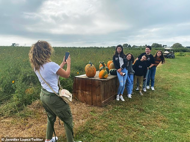 Smile! Jennifer took a cell phone snap of her 12-year-old children posing beside a festive table of pumpkins alongside three of their friends