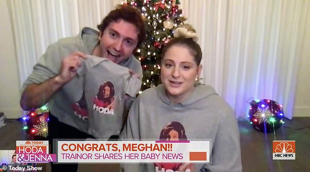 With a onesie: The blonde beauty made the announcement while on the Today show alongside her spouse. 'We're so excited we couldn't sleep,' she said after Daryl blurted out, 'We're pregnant!'