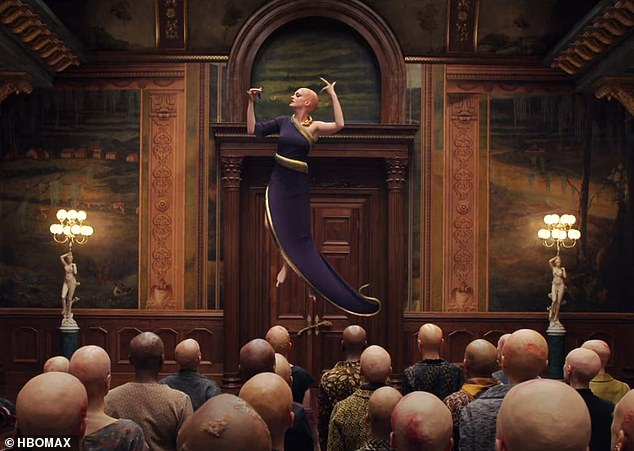 Evil plan: In a shocking scene, Hathaway, who stars as the menacing Grand High Witch, removes her wig and reveals her plan, while hovering in the air