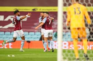 John McGinn of Aston Villa celebrates after scoring his team's third goal.