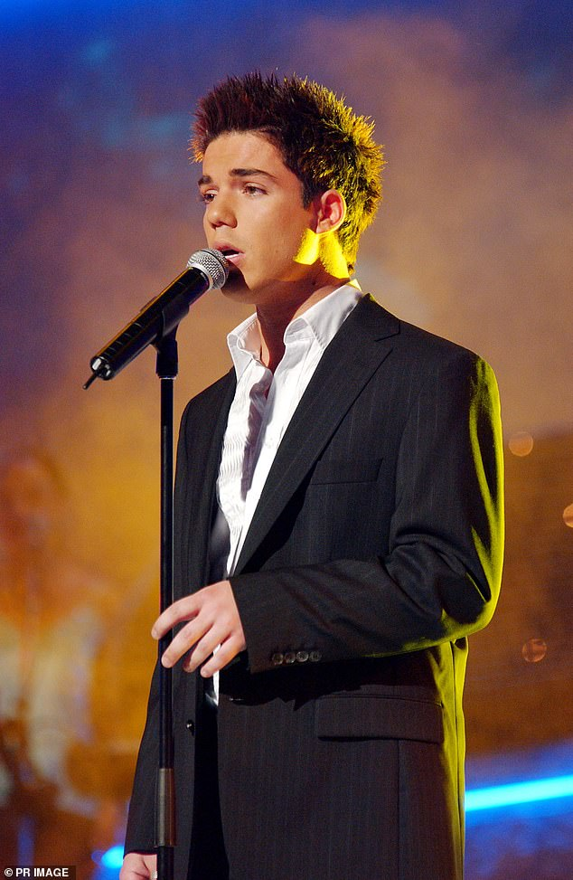 'Leading up to the grand final, everywhere I went I had to have a bodyguard': Anthony said on The Idol Archives podcast that he had to ramp up his personal security following the threat. Pictured during the Australian Idol grand finale in Sydney onNovember 15, 2004