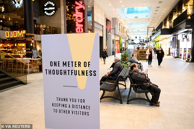 Sweden encouraged social distancing measures but kept much of its economy open throughout the pandemic (pictured, a Stockholm shopping centre)