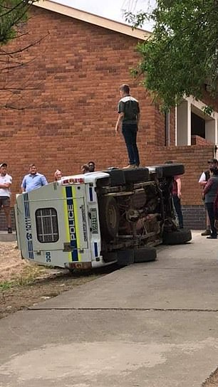 Man stands on a police van