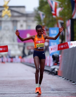 Brigid Kosgei of Kenya crosses the finish line in first place