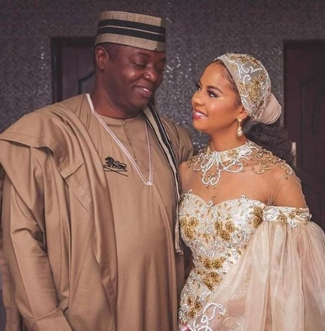 Adama Indimi and her groom Ado Malik inside her wedding dress