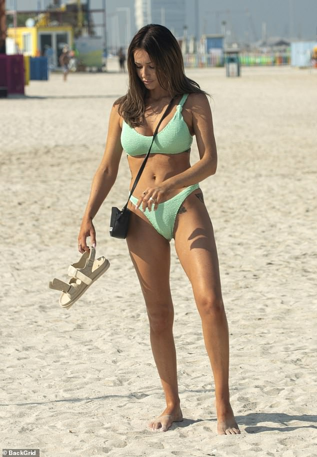 Looking good: The former Love Island star showcased her jaw-dropping figure as she donned a mint green bikini for the outing