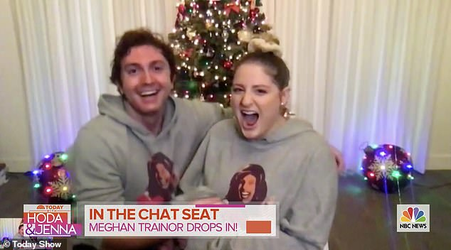 Joy: The Massachusetts native had fun rolling out her big news on the morning show as she and her husband wore matching Hoda Kobt grey hoodies as they posed in front of a festive Christmas tree