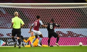 Ollie Watkins of Aston Villa scores the opening goal.