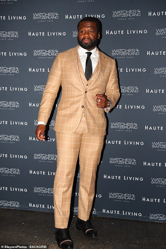 Style: The rap veteran wore a watch and rings with black dress shoes