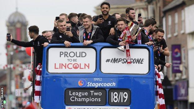 Lincoln City bus parade after winning the League Two title