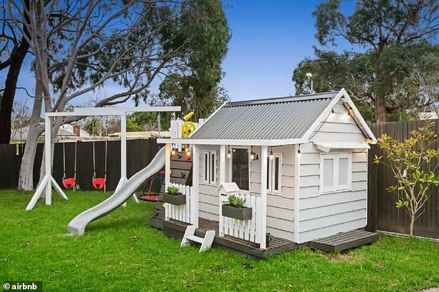 Perfect for kids: Pictured is the cubby house, which matches the design of the home