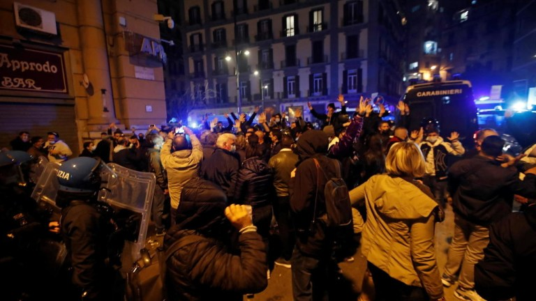 Hundreds protest, clash with police in Naples over new coronavirus curfew