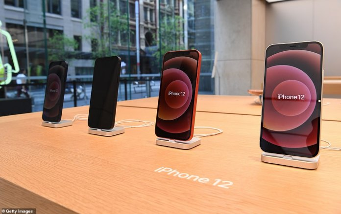 The iPhone 12 features the A14 Bionic chip CPU, 6.1 inch OLED display, 5G connectivity and an advanced dual-camera system. Seen here on display at Sydney's Apple Store