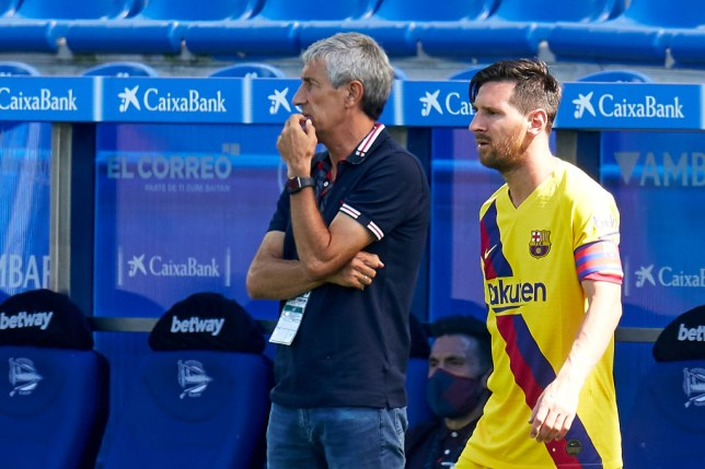 Lionel Messi and Quique Setien, head coach of FC Barcelona looks on during the Liga match between Deportivo Alaves and FC Barcelona at Estadio de Mendizorroza on July 19, 2020 in Vitoria-Gasteiz, Spain.