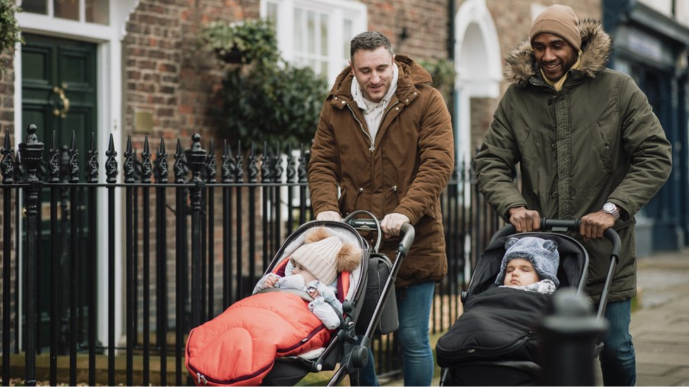 Two dads with pushchairs