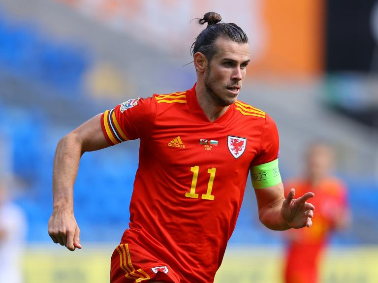 Gareth Bale returns for Wales in squad selected by absent coach Ryan Giggs