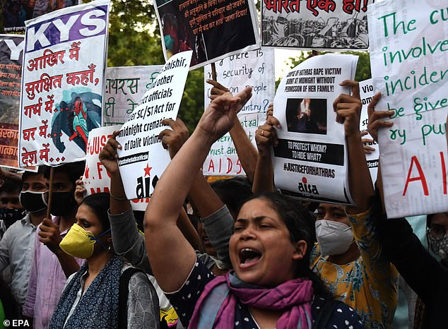 Protesters demand justice an alleged gang-rape of a 19-year-old girl in Uttar Pradesh state during a demonstration in New Delhi on September 29