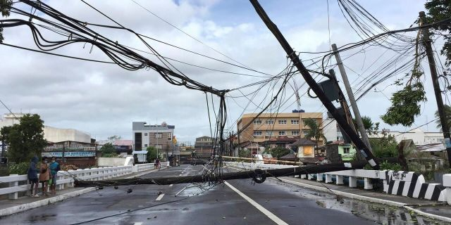Electrical poles are toppled due to strong winds from Typhoon Goni in Daet, Camarines Norte province, central Philippines, Sunday Nov. 1, 2020.