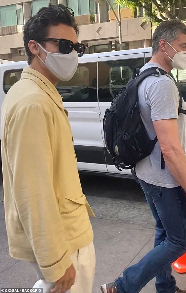 Reporting to set: Harry Styles masked up Wednesday on the set of Don't Worry Darling in Downtown Los Angeles, shortly before production was temporarily halted, when someone tested positive for coronavirus