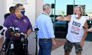 A protester interrupts a news conference to discuss ballot counting in North Las Vegas, Nevada.
