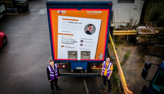 James Pemblington who had not worked for around eight months, who now has a new job thanks to his giant CV being advertised on the back of a lorry - Pictured with Edward Hollands - DrivenMedia. See SWNS story SWMDcv. November 5, 2020. James had tried everything to get another job. He had even sent a chocolate brownie with a QR code on it to potential employers. When the QR code was scanned, it revealed a website showing James??? CV and a video about him, his interests and projects. Then James saw a competition run by Dragons??? Den entrepreneur, Ed Hollands of DrivenMedia and fast-growing UK job board, Zoek to have his image and a giant CV displayed on the back of a huge lorry travelling up and down the UK???s road network. It seemed to him like the logical next step to go from an edible CV to a giant CV on the back of a lorry! Beating almost 200 other job-seekers, James, who lives near Nottingham, won the competition because of his initiative and enthusiasm. The innovative mobile campaign launched on a Wednesday, James was contacted the next day on Thursday, interviewed on Friday and, on Saturday, he???d been offered a three-month contract as a Deputy Site Manager with Serco at the Burton-on-Trent Covid-19 Track and Trace Test Centre.