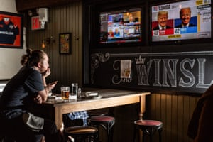 People watch election results at the Winslow in Manhattan, New York on 3 November.