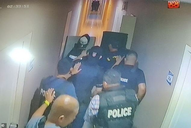 Armed police stormed the suspect's apartment afterordering the area to be locked down