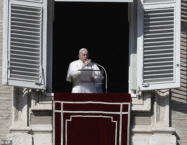 The 83-year-old said we need to 'change' and take responsibility for others. Above, Pope Francis delivers the Angelus noon prayer in St. Peter's Square at the Vatican on November 1