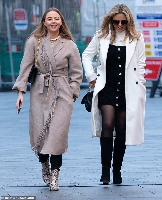 In good company: Emily was joined by a stylish looking friend as she made her way across Leicester Square