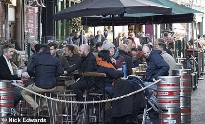 Pictured, drinkers in Borough Market today