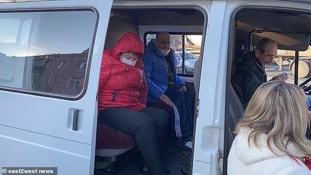 Anatoly Moskvin pictured getting into a police van.