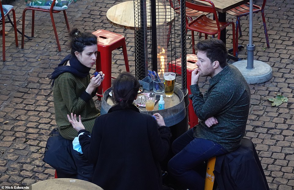 Friends in London will not be able to meet at a pub for at least another four weeks when the lockdown kicks in
