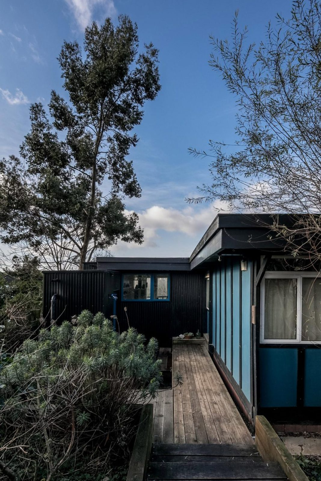 Profiled metal sheet cladding on extension