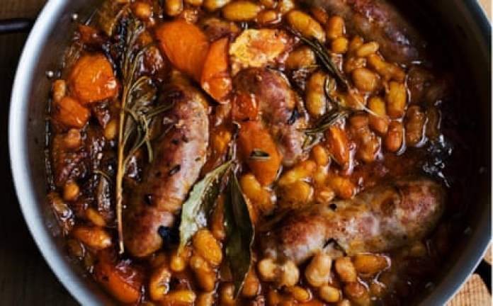 Pork on a fork ... Nigel Slater's beans and sausage with harissa