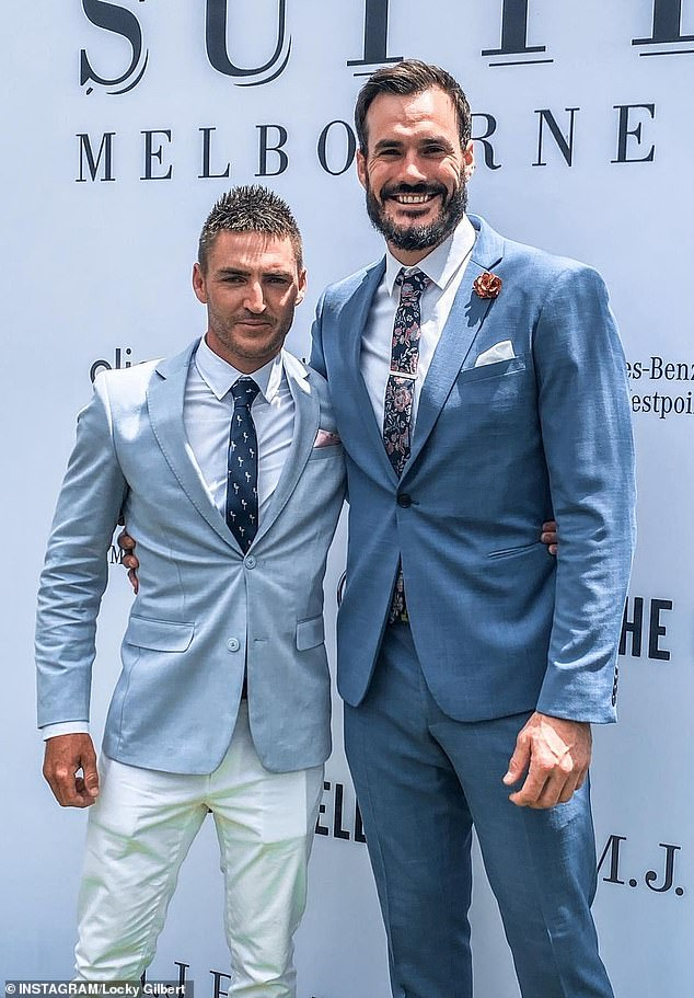 Hmm! Fans' curiosity piqued again on Wednesday when Locky shared a photo to Instagram of himself with a male friend (left) at the event, while making no mention of Irena's whereabouts