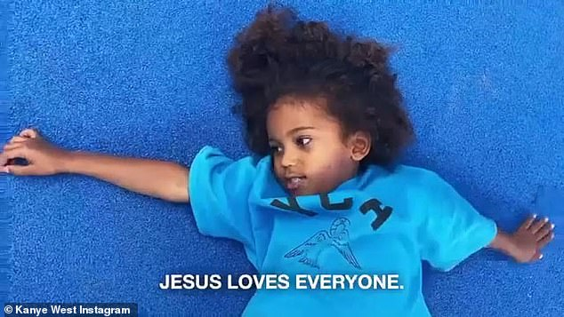Joining in: Saint, four, is also seen saying the words 'Jesus loves everyone'