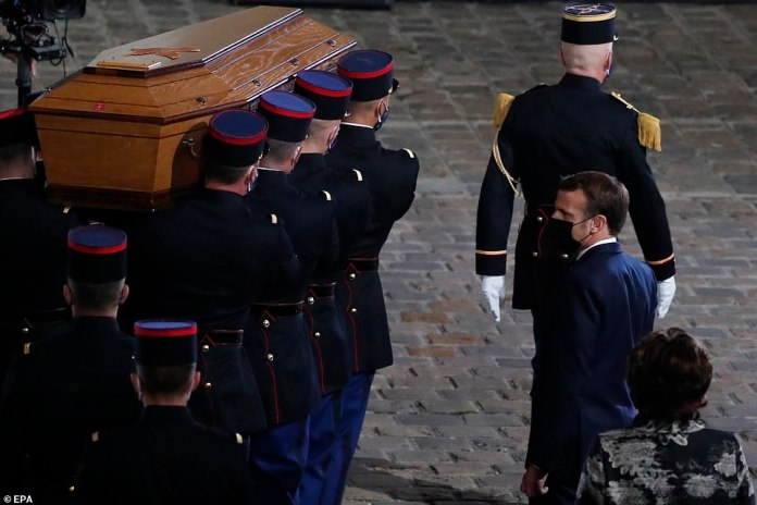 French President Emmanuel Macron watched the coffin of slain teacher Samuel Paty being carried into the courtyard of the Sorbonne university during a national memorial event in Paris last night