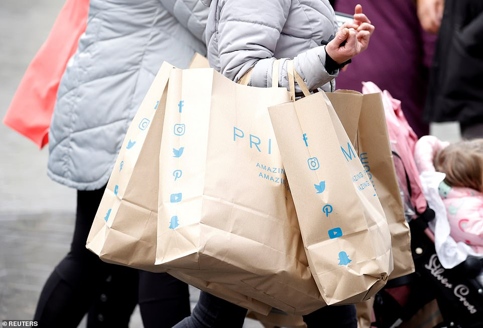 People emerged from the stores laden with bags of shopping today - before they are forced to stay in from tomorrow