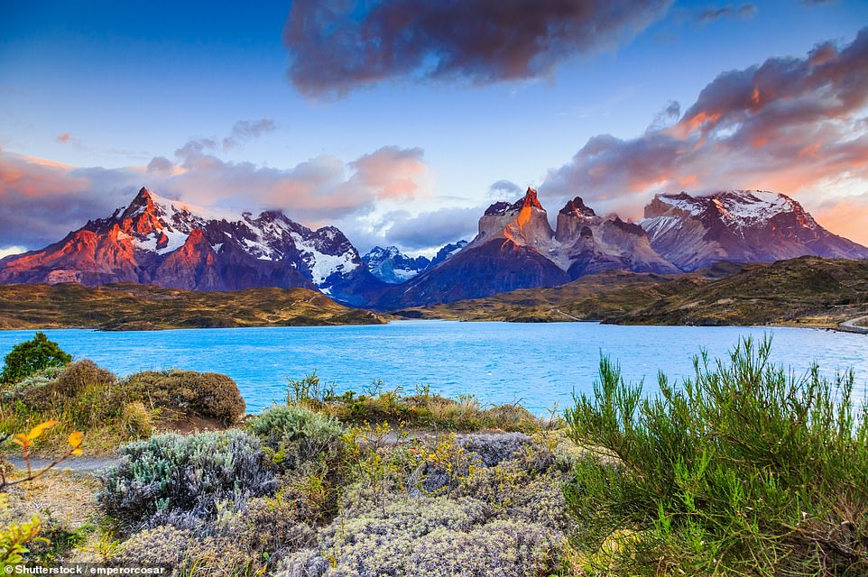 1. TORRES DEL PAINE NATIONAL PARK, CHILE: This stunning national park is located in Chile's southern Patagonia. Big 7 Travel says: 'From the ancient glacial lakes to the jagged range of Cordillera, from roaming pumas and endless grazing guanaco [a relative of the llama], Torres del Paine is the epitome of wilderness and takes first place for the most beautiful places in the world'