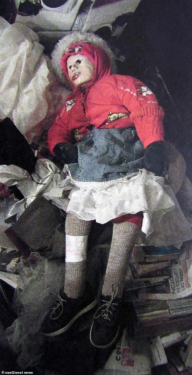 One of the dolls found in the flat.The grave robber has refused to apologise to his victims' parents as he attended a custody hearing