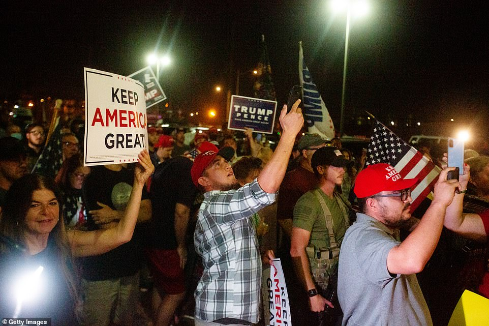President Donald Trump supporters gather to protest the election results at the Maricopa County Elections Department office