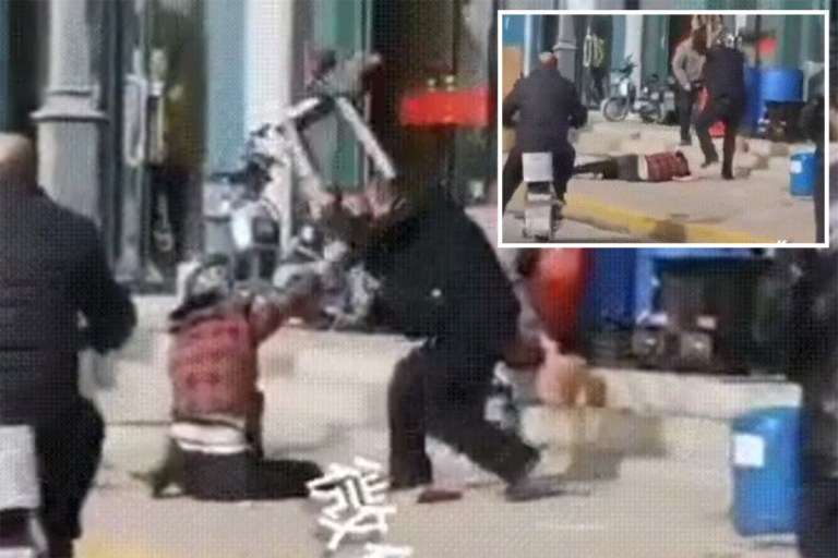 Horrific moment 'husband beats his wife to death in the street' as onlookers do nothing sparking global outrage