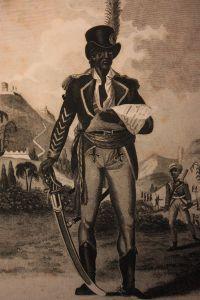 Toussaint Louverture, 1743-1803. O Toussaint ήταν γιος μορφωμένων σκλάβων, αποκτώντας έτσι αλλά και μέσω Ιησουϊτών γνώσεις Γαλλικών. Στην αρχή η εξέγερση τον άφησε αδιάφορο, αλλά σύντομα διέκρινε την ανικανότητα των ηγετών των ανταρτών. Όταν τελικά συντάχθηκε με τους εξεγερμένους, η αναρρίχηση του στην ιεραρχία τους ήταν αλματώδης και οι ηγετικές του ικανότητες αδιαμφισβήτητες, κερδίζοντας το προσωνύμιο ''Μαύρος Σπάρτακος''.