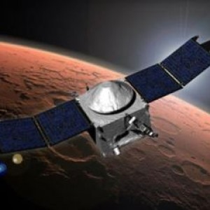 NASA's MAVEN atmospheric research satellite, shown in this artist's impression, braked into orbit around Mars Sunday evening, kicking off a year of close-range observations to learn more about what caused much of the martian atmosphere to leak away in the distant past. NASA