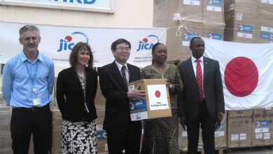 Mr. Nikai (middle) handing over the relief items to Mrs Ruhle (2nd right)