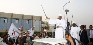 Sudanese President Omar al-Bashir wave to supporters after he returned to the Sudanese capital Khartoum on June 15, 2015. Omar al-Bashir on Monday returned to Khartoum from South Africa after he attended the 25th summit of the African Union (AU) there. (Xinhua/Mohamed Khidir)
