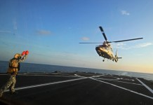 "A Dolphin Z-9 helicopter of China's Navy missile frigate CNS Yulin flies off the deck of Singapore's Navy missile frigate RSS Intrepid during the ""Exercise Maritime Cooperation 2015"", May 25, 2015. The Singapore and Chinese navies concluded the inaugural Exercise Maritime Cooperation 2015 on May 25. (Xinhua/Then Chih Wey)"