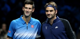 Novak Djokovic (L) of Serbia and Roger Federer of Switzerland pose ahead of the men's single's final at the ATP World Tour Finals at the O2 Arena in London, Britain, Nov. 22, 2015. Djokovic won 2-0. (Xinhua/Han Yan)