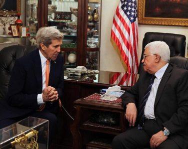 U.S. Secretary of State John Kerry meets with Palestinian President Mahmud Abbas (R) at the Palestinian ambassador's residence in Amman, Jordan, Feb. 21, 2016. [Xinhua/EPA/POOL/JAMAL NASRALLAH]