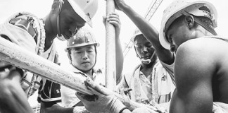 Chinese engineer Zhang Qingchun (L2) and Kenyan workers work at the Mombasa West Station. [People's Daily]